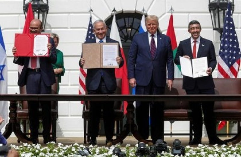 Bahrain's Foreign Minister Abdullatif Al Zayani;  Israel's Prime Minister Benjamin Netanyahu and United Arab Emirates (UAE) Foreign Minister Abdullah bin Zayed display their copies of the signed agreements, alongside United States President Donald Trump in the garden south of the White House (Reuters)