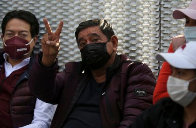 Felix Salgado flashes a V hand sign during a protest outside the Electoral Tribunal to demand a reversal of the decision to remove him as a gubernatorial candidate, in Mexico City, Wednesday, April 7, 2021. Mexico's election agency withdrew the ballot registration of Salgado who was nominated by Mexico's ruling Morena party despite accusations of rape against him, saying he failed to report the money he spent during the primary process. (AP Photo/Fernando Llano)
