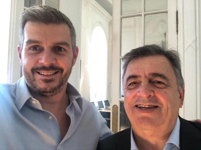 Marcos Peña, ayer, junto a Mario Negri