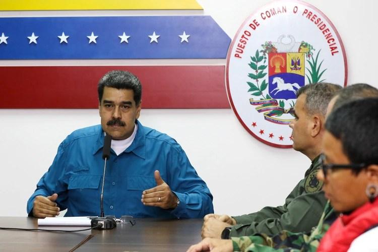 El dictador venezolano Nicolás Maduro y los miembros del gobierno durante su discurso televisado (Palacio de Miraflores via REUTERS)