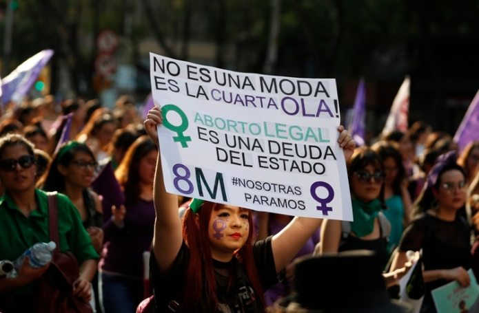 In this archive photo of March 8, 2019, a protester holds up a poster supporting the decriminalization of abortion during a feminist mobilization on International Women's Day in Mexico City (Photo: AP)