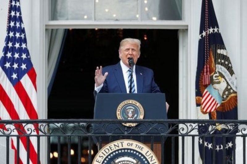 The president of the United States, Donald Trump, speaks to his followers from a balcony of the White House in Washington