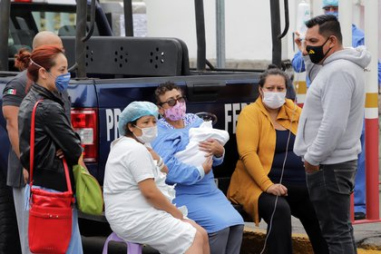 Patients are seen outside a hospital treating people with the coronavirus disease (COVID-19), in the aftermath of a quake, in Puebla, Mexico June 23, 2020. REUTERS/Imelda Medina