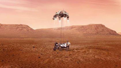 Imagen cedida por la NASA que muestra una ilustración del rover Perseverance mientras aterriza de forma segura sobre la superficie de Marte. EFE/ Emma Howells/ NASA