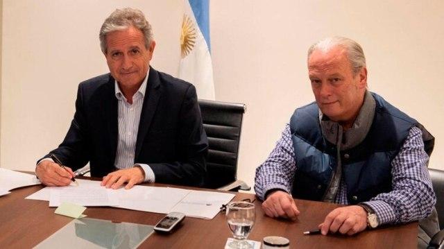 Andrés Ibarra y Andrés Rodríguez, en el despacho de la Casa Rosada, firmaron la paritaria de los estatales