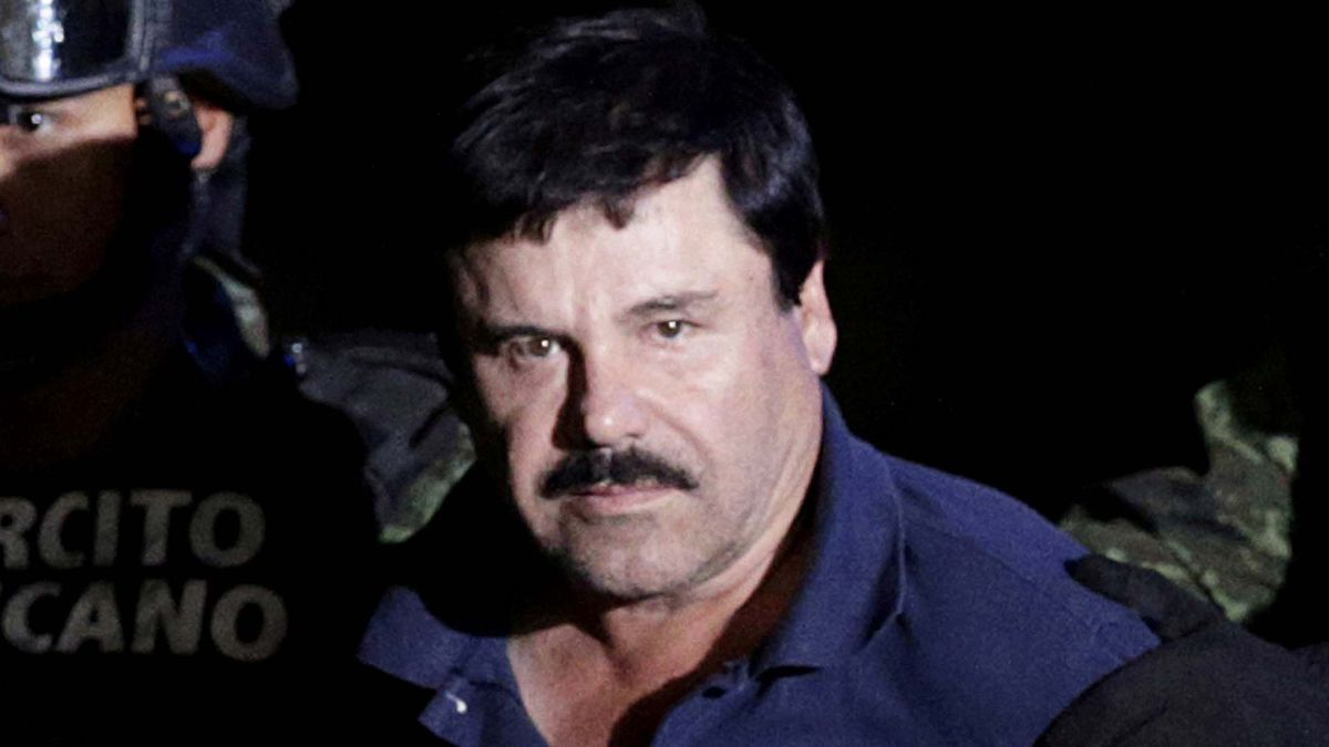 FILE PHOTO Recaptured drug lord Joaquin El Chapo Guzman is escorted by soldiers at the hangar belonging to the office of the Attorney General in Mexico City
