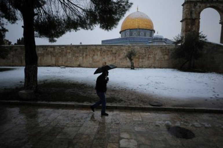 A man walks by the Dome of the Rock on a snowy morning in Jerusalem's Old City, February 18, 2021. REUTERS / Ammar Awad
