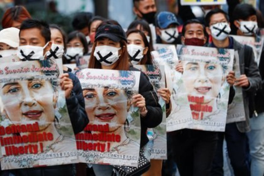 Protesters hold up posters with the image of Aung San Suu Kyi during a march to protest against the military coup in Myanmar, in central Tokyo, Japan February 14, 2021. REUTERS / Kim Kyung-Hoon