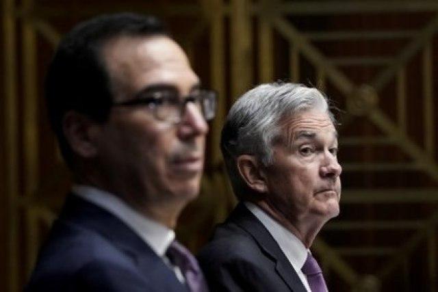 Steven Mnuchin y Jerome Powell (Reuters)