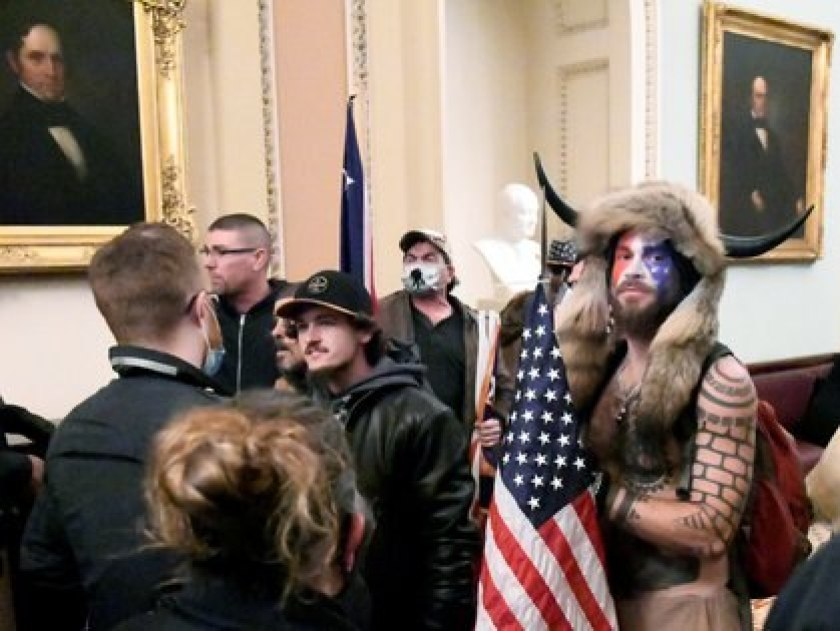 Jake Angeli in the Capitol dressed as a Sioux warrior.  Photo by Mike Theiller, REUTERS