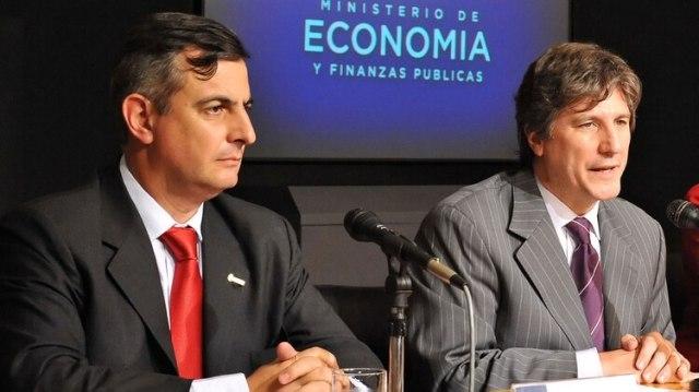 Daniel Reposo, ahora designado en la AFIP, cuando se desempeñaba como síndico de la Nación; aquí, en una conferencia de prensa con el entonces ministro de Economía, Amado Boudou
