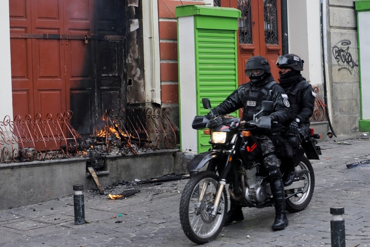 Members of the security forces ride a motorcycle during clashes with supporters of former Bolivian President Evo Morales, in La Paz, Bolivia November 13, 2019. REUTERS/David Mercado