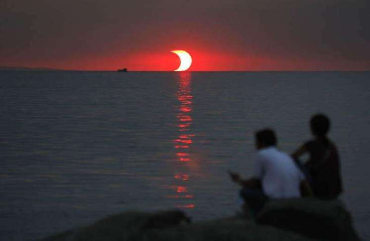 Sunset and Eclipse Happening at the Same Time