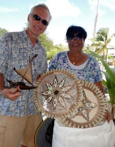 Cruiser Robert Yapp donates a sail to Ailuk. Grateful Mayor Rufina Jack gave him handicrafts in return.