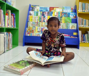 A young girl was spotted looking at a selection of books in the children's section of the Alele Library. Photo: Karen Earnshaw