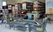 Children enjoy the comfort of the living-room style seating in the Alele Library. Photo: Karen Earnshaw