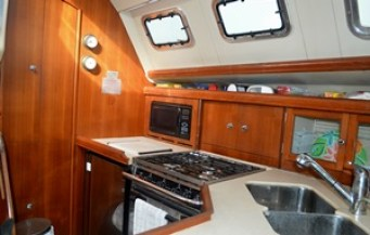 The galley, with the refrigerator at left.