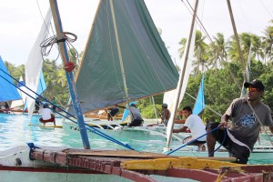 Captains ready their traditional Marshallese canoes for a race. Photo: Rebecca Lathrop