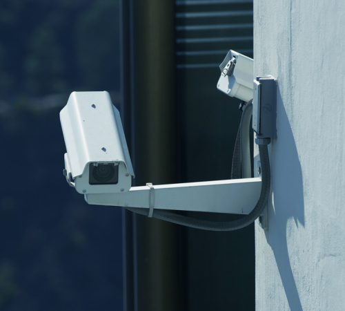 CCTV Security Cameras on the Building Wall. Visual Security System. Technology Photography Collection.