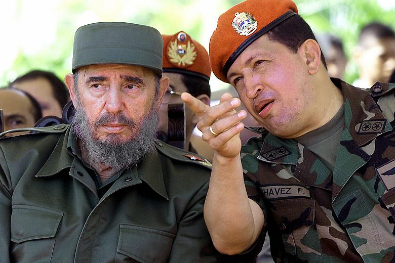 Cuban leader Fidel Castro and Venezuelan Hugo Chavez talk in Pampatar Bay near Caracas in 2001