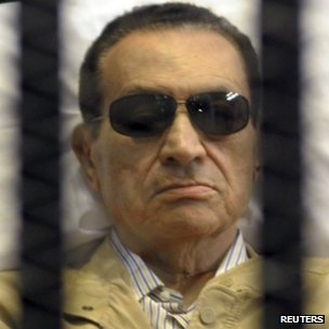 A DEFIANT HOSNI MUBARAK BEHIND BARS. SUFFERED CRACKED RIBS & FLUID IN LUNGS