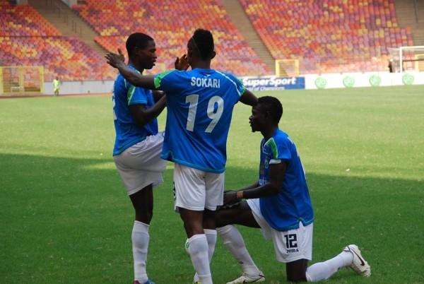Kingsley Sokari Celebrates With Abdulrahaman Bashir During a Pre-Season Match in Abuja in 2014. Image: LMC.