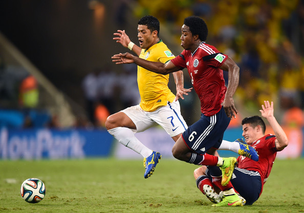 Carlos Sanchez Vies for the Ball With Brazil's Hulk During their Quarter-Final Clash at the World Cup.