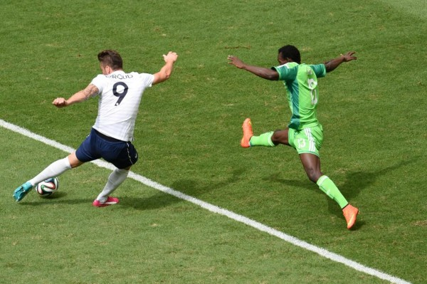 Juwon Oshaniwa Stretches to Deny Olivier Giroud a Shot at Super Eagles Goal. Image: Getty.