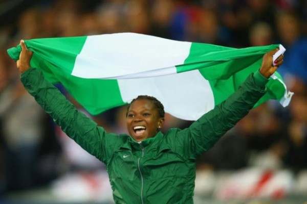 Ese Brume Celebrates Winning Gold in Long Jump at the Glasgow Commonwealth Games. Image: Getty.