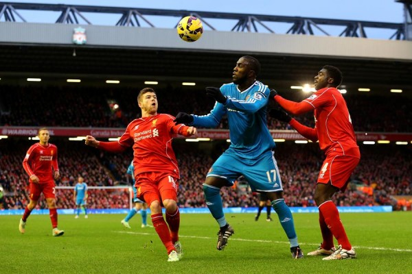 Jozzy Altidore in a Tussle With Liverpool Defenders. Action Image.