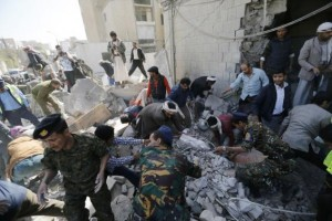 Rescuers search for survivors at the residence of the Iranian ambassador after a car bomb attack in Sanaa