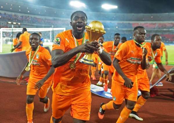 Kolo Toure Celebrates With His Cote d'Ivoire Team-Mates after Their 2015 Triumph in Equatorial Guinea. Image: AFP.