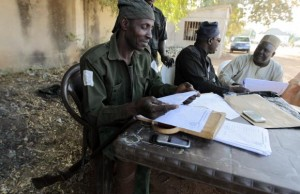 Militia hunters helping the army to fight the Boko Haram insurgence hold a meeting in Yola