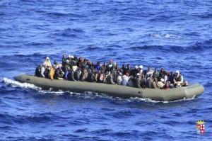 Migrants are seen in a boat during a rescue operation by Italian navy ship San Marco off the coast to the south of the Italian island of Sicily