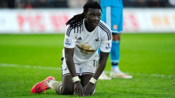 Bafetimbi Gomis Collapses at White Hart Lane. Image: Getty.