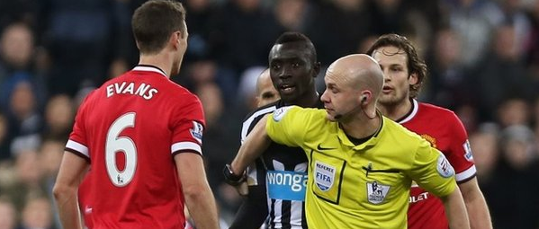 Jonny Evans and Papiss Cisse Clash in the First Half of Newcastle's 1-0 Home Defeat By Manchester United. Image: Getty.