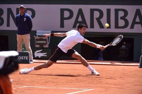 Novak Djokovic Scampers to Return Play against Richard Gasquet. Image: RG via Getty.