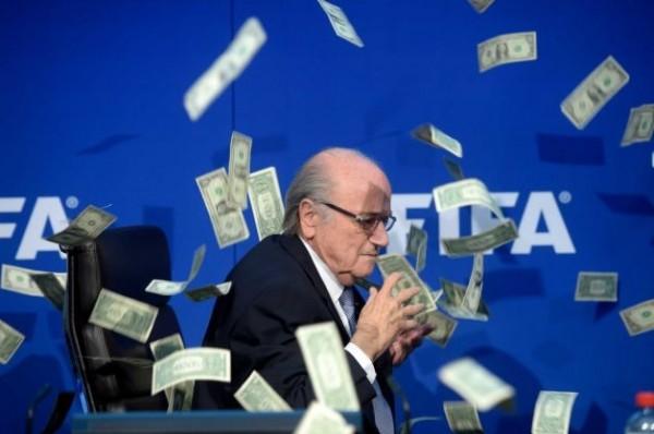 Blatter Ducks as Lee Nelson's Fake Dollar Bills Rain on Stage.