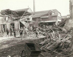 American soldiers father around the aftermath of a shelling. General Palmer wrote: 'Shell from Railway did this. Not far from where I live. Five bigger ones hit about 150 yards from my place the others .. (?). One blew the door in on my caravan. The place was a mess.