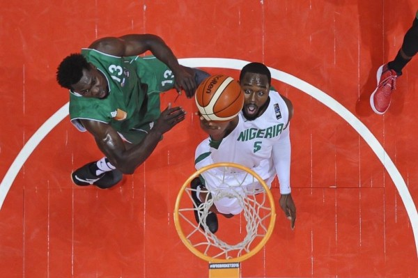 Nigeria's Mike Umeh Goes for a Basket against the Central African Republic. Image Credit: twitter/NigeriaBasket