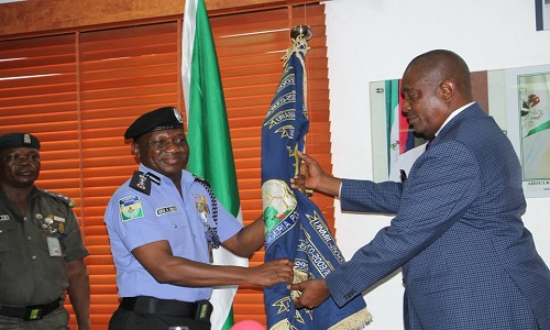 Mr. Solomon Arase in a symbolic handover of mantle of leadership to Ag. Inspector-General of Police, AIG Idris Kpotun on Wednesday at Force Headquarters, Abuja.