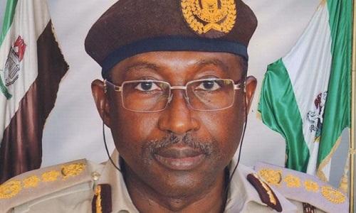 Image result for Comptroller-General of Immigration, Mohammed Babandede