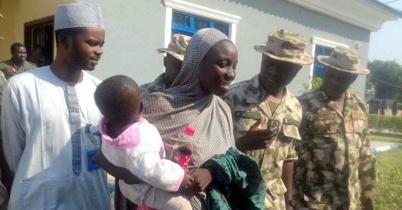 Rescued Chibok girl Maryam Ali Maiyangaand her 8-month-old baby with Nigerian military officials in Borno state