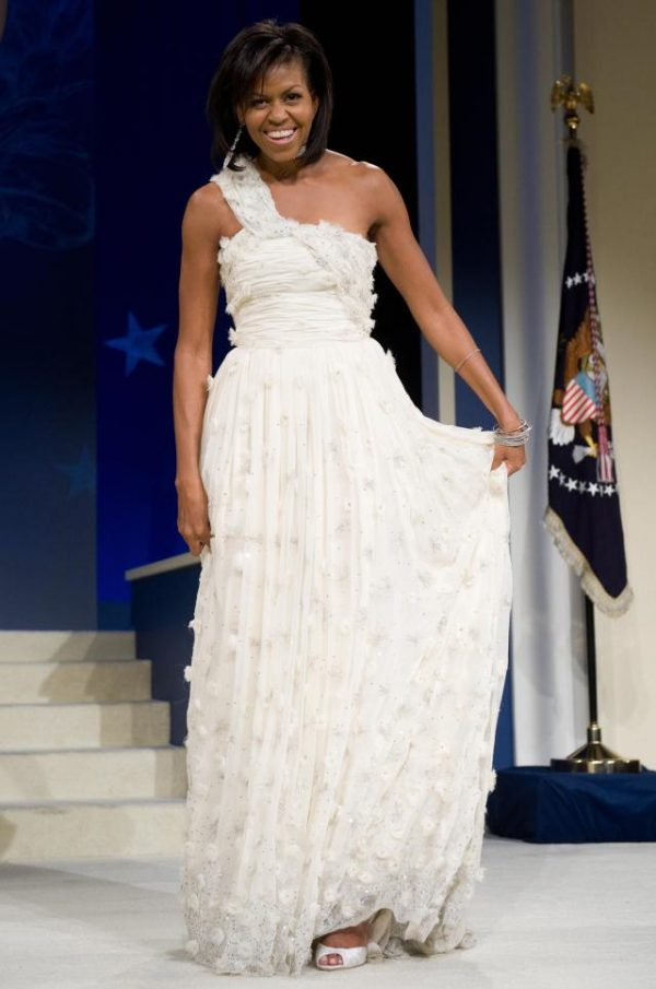 First Lady Michelle Obama poses during the Midatlantic Regional Inaugural Ball at the Washington Convention Center in Washington, DC, January 20, 2009. Obama was sworn in as the 44th US president earlier in the day. AFP PHOTO / Saul LOEB (Photo credit should read SAUL LOEB/AFP/Getty Images)