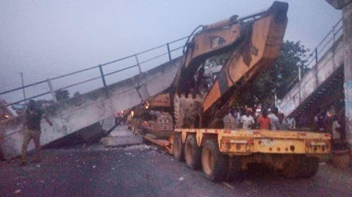 Tragedy Averted as Truck Carrying a Bulldozer Accidentally Pulls Down a Pedestrian Bridge in Osun | Photos