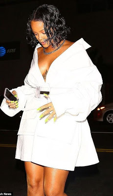 Check out Rihanna, as she flashes side b00b, chest tattoo in revealing oversized white dress at a fashion launch