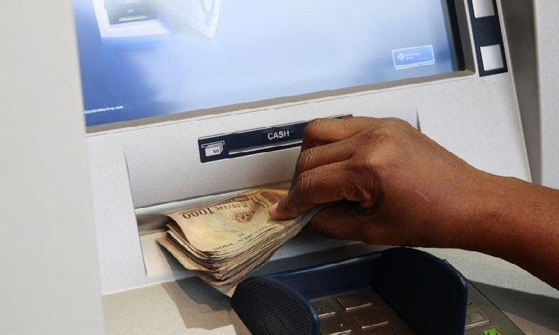 atm cash - Video: Heartbreaking moment elderly woman cried bitterly at ATM spot, after fraudsters swindled her of all she has