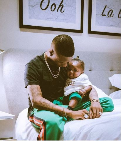 wizkid gifts son zion a customized diamond neck piece - StarBoy To Drop Two Albums This Year