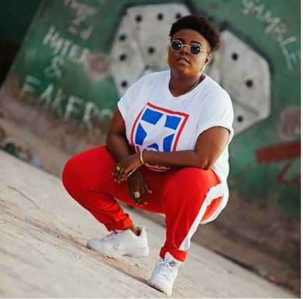 singer teni shares throwback photo of a peculiar santa claus she once visited - Tired of these crazy charges!!! Teni cries out