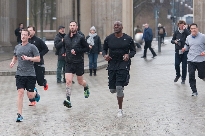 Mark Zuckerberg jogging accompanoed by bodyguards - Facebook Spends $22.6m To Keep CEO, Mark Zuckerberg Safe